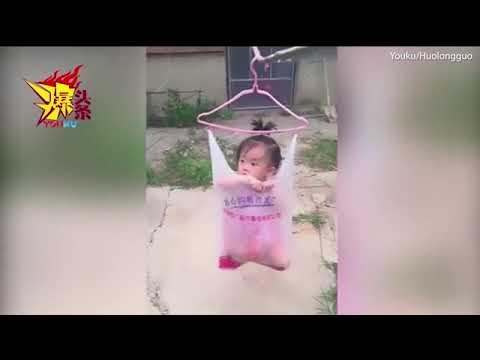 صوت الإمارات - أم تعلق طفلتها بكيس بلاستيك على حبل غسيل