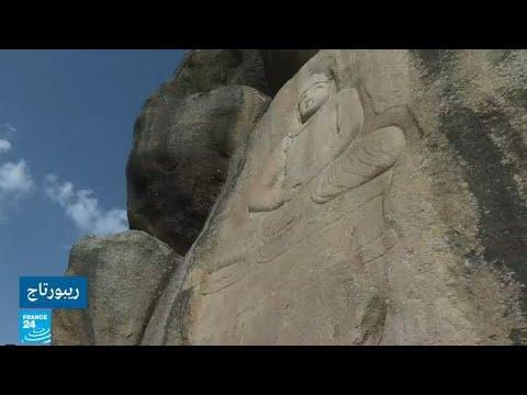 ترميم تمثال بوذا في وادي سوات الذي حاولت طالبان تفجيره