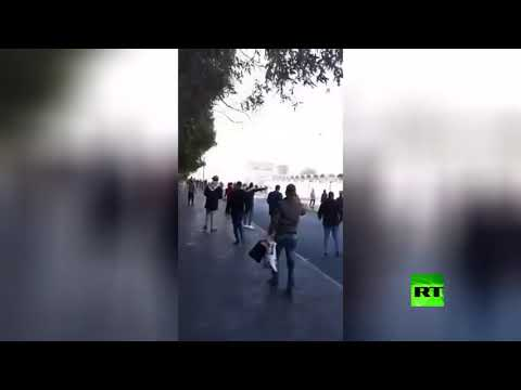 شاهد صدامات بين محتجين وقوات الأمن جنوب العراق