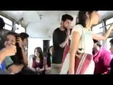 فتاة تتحرش بأحد الشبان داخل إحدى الحافلات