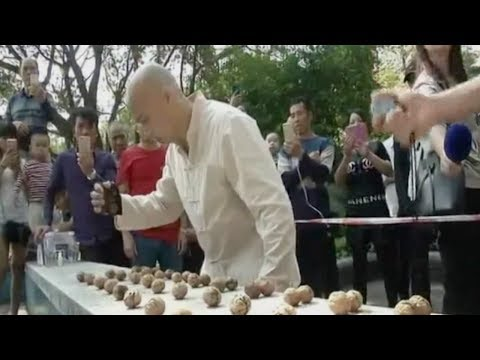 new world record for smashing walnuts with bare hands set