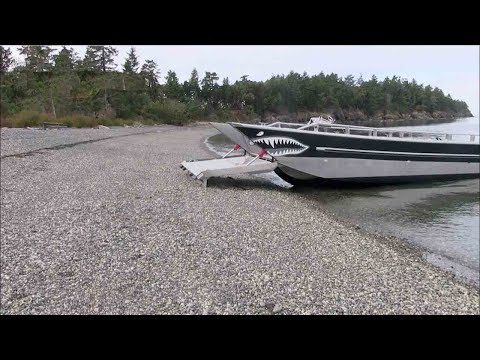 boat climbs itself up the shore
