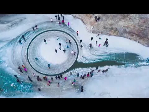 drone video shows rotating ice circle in frozen river in ne china