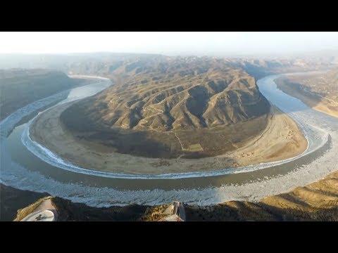 aerial view of ice sheets in asias third longest waterway