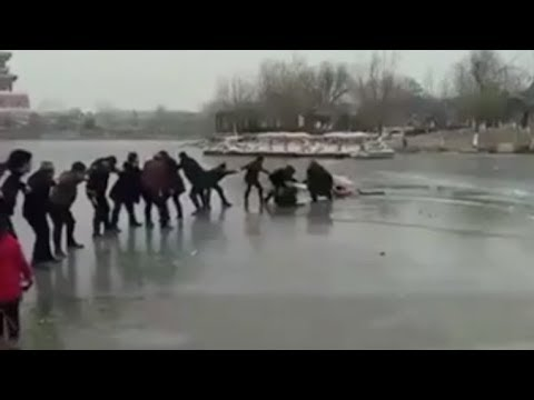 human 'chain' rescues tourists from ice hole in a lake