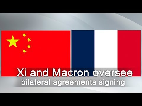 live xi macron oversee bilateral agreements signing
