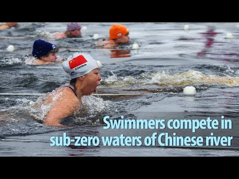 swimmers compete in subzero waters of chinese river