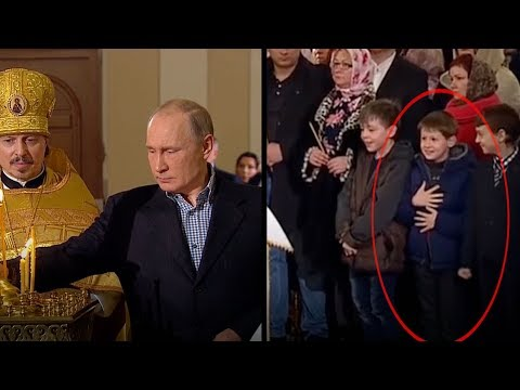 young boys can't contain themselves when president putin shows up for christmas eve mass