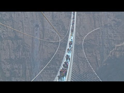 worlds longest glassbottom bridge opens in north china
