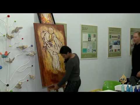 صوت الإمارات - بالفيديو الرسم يجمع ثقافات العالم في مدينة الدوحة