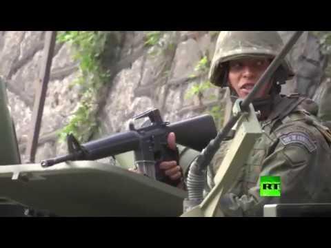 صوت الإمارات - شاهد الجيش البرازيلي يطوّق أكبر منطقة في ريو دي جانيرو