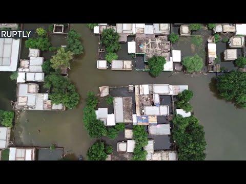 شاهد فيضانات النيل الأزرق تسبب في غرق مدينة سنجة في السودان