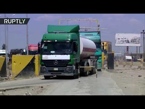 شاهد أولى شاحنات تعبر منفذ عرعر الحدودي بين العراق والسعودية