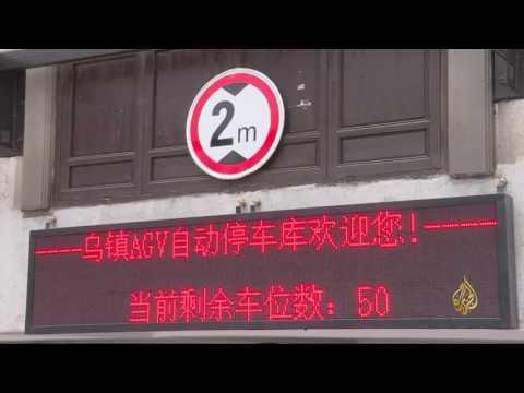 صوت الإمارات - بالفيديو  روبوت صيني جديد يستخدم لركن السيارات